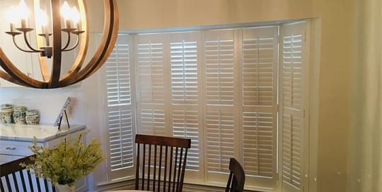 SL 300 vinyl shutters installation in a bay window.